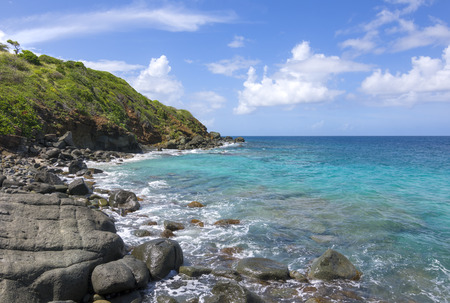turquoise water: Rocky coastline and turquoise blue water on northeast coast of Isla Culebra in Puerto Rico on sunny day Stock Photo