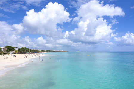 PLAYA DEL CARMEN, MEXICO - NOVEMBER 8, 2016: Beautiful turquoise water and white sandy beaches with coconut palms and small boutique hotels make Playa del Carmen an attractive vacation destination for tourists from all over the world.