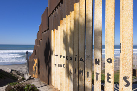 Vertical steel girders create the border wall between Mexico and the United States at the beach in Tijuana, Mexico
