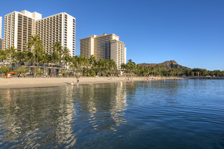 WAIKIKI, OAHU, USA - JANUARY 27, 2017: Waikiki Beach has something for everyone with its modern infraestructure and first class ammenities to its beautiful calm beach and gorgeous sunsets and views.