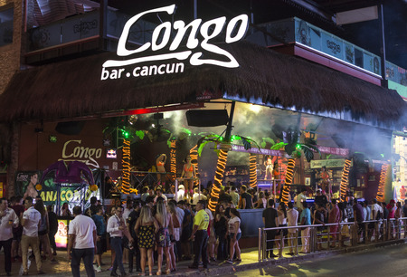 CANCUN, MEXICO - MARCH 1, 2017: The popularity of Cancun as a Spring break destination is partly due to the lively nightlife featuring attractive go-go dancers and open visibility of nightclub interiors.