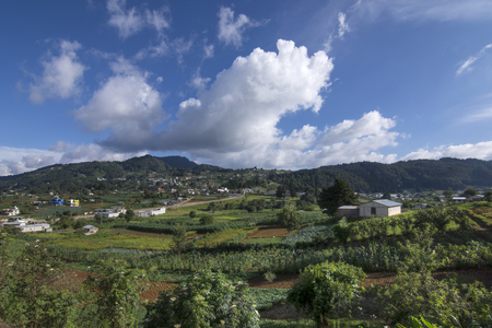 Beautiful wide angle countryside landscape and farmland of San Juan Chamula in Chiapas, Mexico on warm summer day