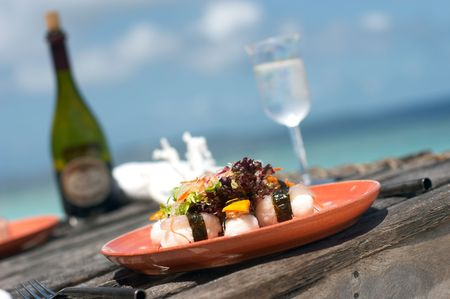 sushi plate: lunch served at the beach close to the ocean Stock Photo