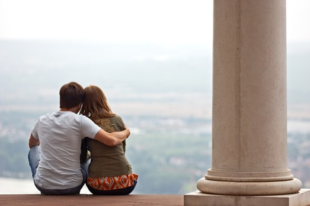 viewpoint: Young loving couple enjoing views from high viewpoint
