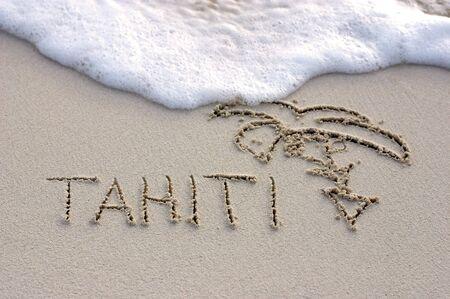 tahiti: Nice Tahiti note written on white sand with ocean waves on background