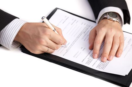 businessman signing documents: Businessman signing a contract