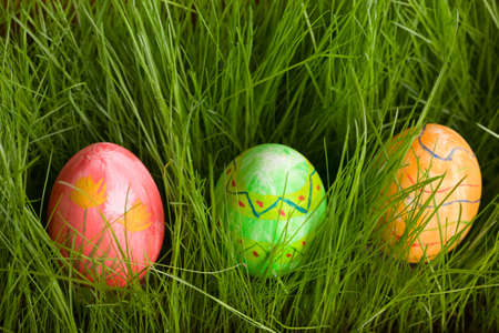 Three Easter eggs in fresh green grass photo