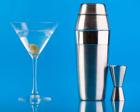 martini shaker: Dry Martini, Shaker and Measure glass over colorful blue background Stock Photo