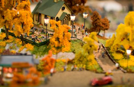 miniature people: Toy city. Miniature city in orange fall colors.