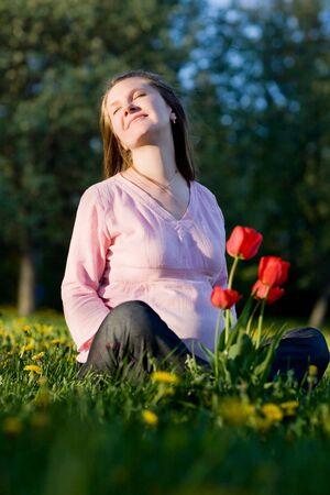 Beautiful pregnant woman enjoying summer sunny day photo