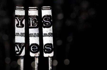 typewriter key: Word YES composed from keys of vintage typewriter