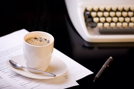 workday: Good morning.  Old fashioned morning scene: antique typewriter, cup of fresh coffee, business contract and pen