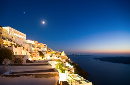 fira: Fira main village of greek island Santorini and spectacular caldera by night