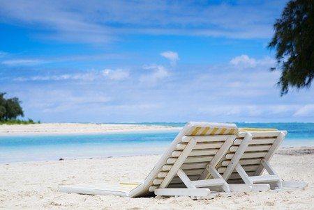 Sun beds on tropical white sand beach. Taken in Mauritius. Stock Photo - 4002415