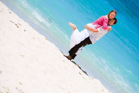 Young happy couple on white sand beach Stock Photo - 4080185