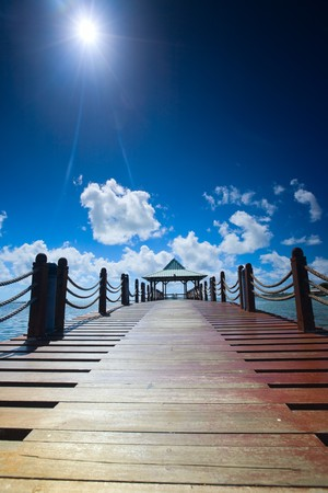 Wooden pathway leading to beautiful hut Stock Photo - 4132179