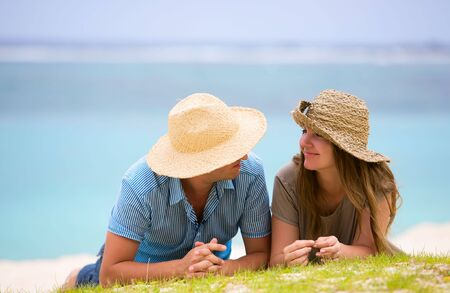 honeymoon couple: Young happy couple on white sand beach