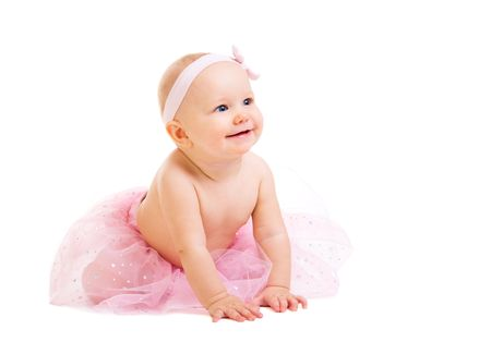 Baby Ballerina. Very cute happy baby girl wearing ballerina skirt. Isolated on white.