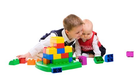 Brother and sister playing together with building blocks Stock Photo - 4292168