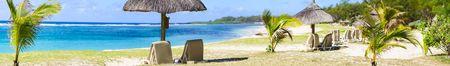 Tropical Paradise. Sun beds on tropical white sand beach.  photo