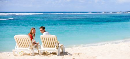 Young happy couple on white sand beach Stock Photo - 4292172