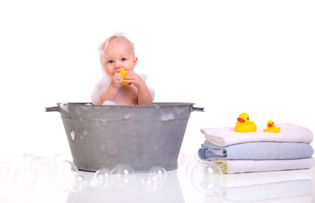 Bath Time. Cute happy baby girl having bath. Isolated on white. Stock Photo - 4292178