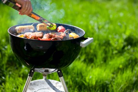 barbecue: Grilling at summer weekend. Fresh meat and vegetables preparing on grill.
