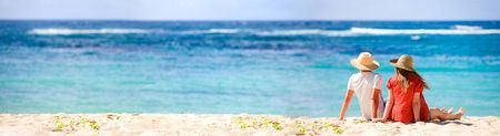 Panoramic photo of romantic couple in tropical paradise photo