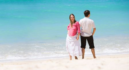 Young happy couple on white sand beach Stock Photo - 4318742