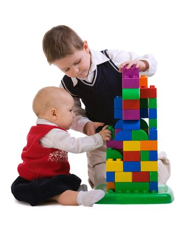 Brother and sister playing together with building blocks Stock Photo - 4379506
