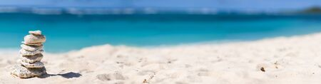 Panoramic photo of  stack of white corals on tropical beach photo