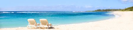 tropical paradise: Tropical Paradise. Panorama of tropical white sand beach with sun beds.