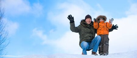 winter day: Winter weekend. Panorama of father and son on beautiful winter day outdoors. Stock Photo