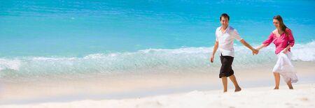 Panorama of romantic couple on white sand beach Stock Photo - 4415741