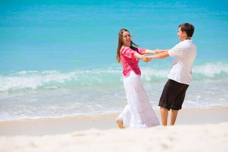Romantic couple having fun on white sand tropical beach Stock Photo - 4427636