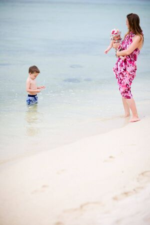 Young mother with two kids on white sand tropical beach Stock Photo - 4476945