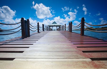 Wooden pathway leading to beautiful hut Stock Photo - 4476958