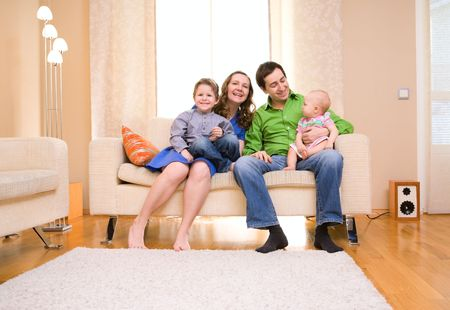 Happy young family of four enjoying time at their home Stock Photo - 4524955