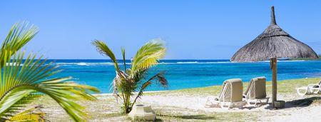 Tropical Paradise. Sun beds on tropical white sand beach.  Stock Photo - 4532068