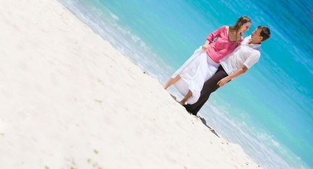 Young happy couple on white sand beach Stock Photo - 4524905