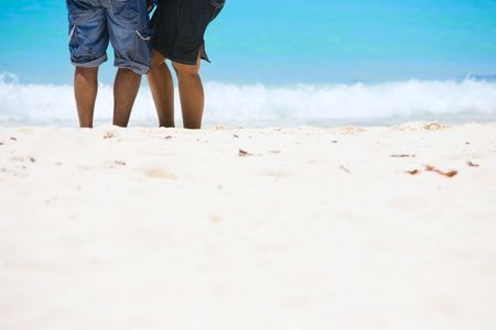 African American couple on white sand beach