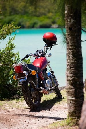 Motorbike parked by the beach photo