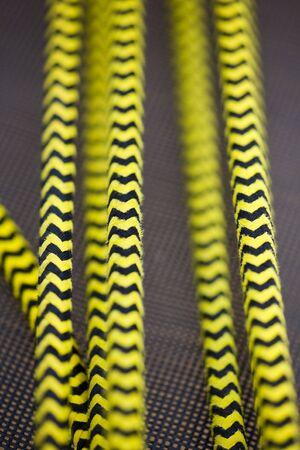 Yellow and black rope closeup photo