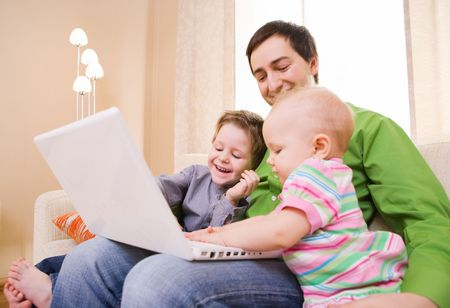 babysitting: Young father and two kids with laptop
