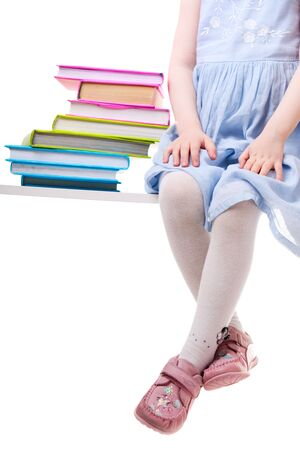 Back To School. Little girl with books isolated on white background Stock Photo - 4774132
