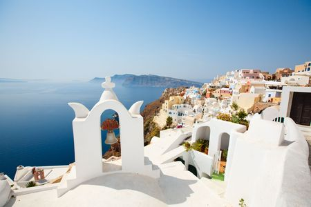 Blue domed church in Oia overlooks the spectacular caldera surrounding the beautiful island of Santorini, Greece Stock Photo - 4806280