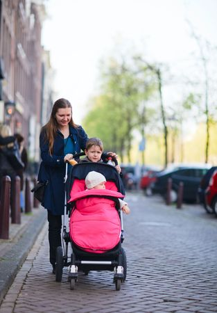 Mother with two kids outdoors walking photo