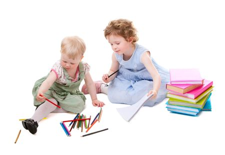 Little girls drawing with pencils. Isolated on white. photo
