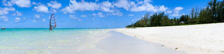tropical paradise: Tropical paradise. White sand beach, turquoise ocean and blue sky. Stock Photo