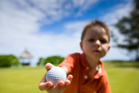 4 years old boy with golf ball Stock Photo